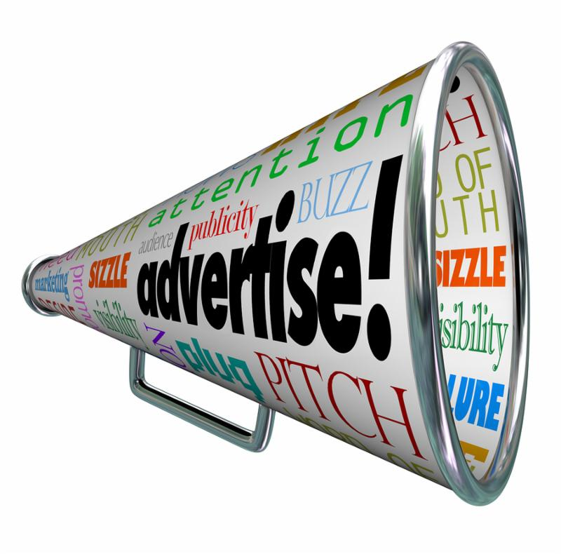 A bullhorn megaphone covered with words describing advertising such as copy